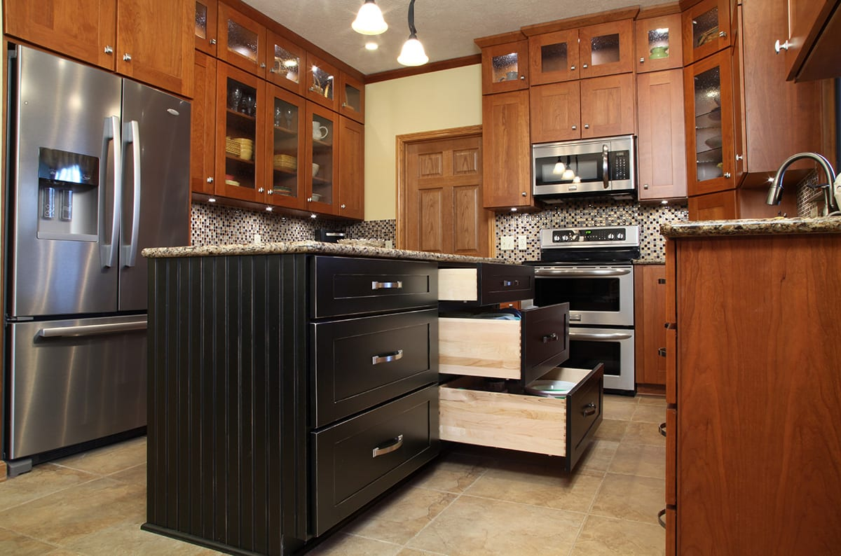 Contemporary kitchen with kitchen island featuring drawer bank with deep drawers for storage