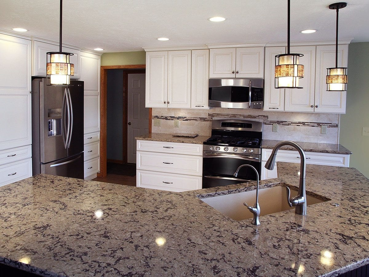 Contemporary kitchen featuring an oversized kitchen island with sink