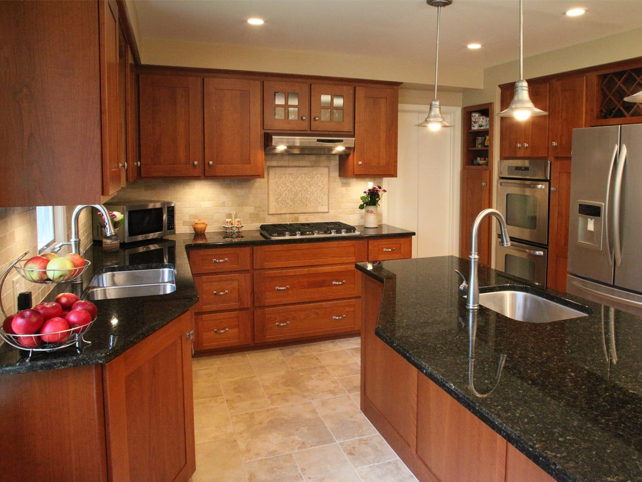 a picture of a brown kitchen after refacing featuring beautiful center island countertops with a sink