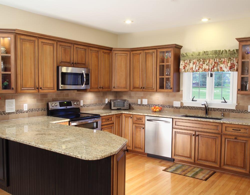 Kitchen with Giallo Ornamental granite countertops