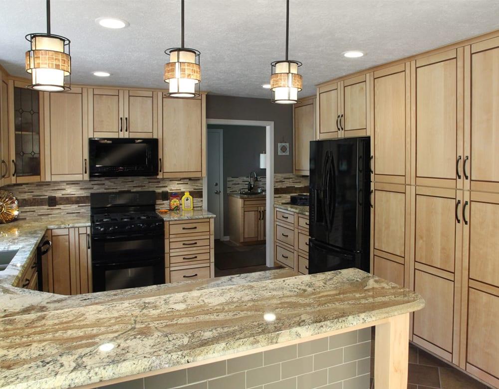 Kitchen with Neptune Bordeaux granite countertops