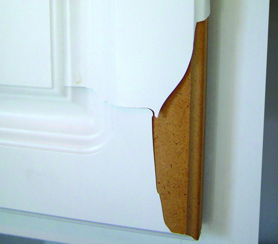Peeling white thermofoil cabinets
