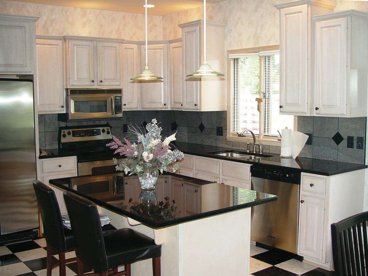Black and white kitchen before cabinet refacing
