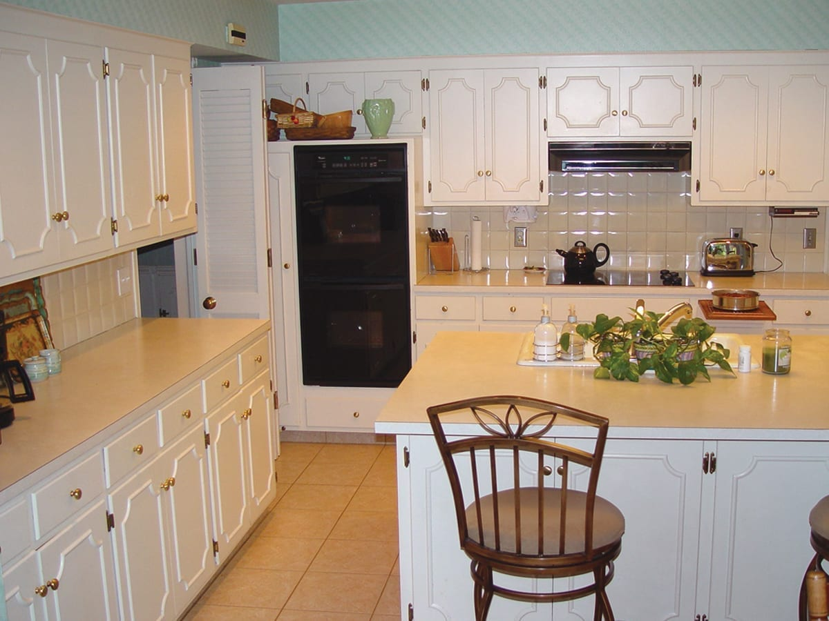 Traditional, dated kitchen before remodeling work done by American Wood Reface