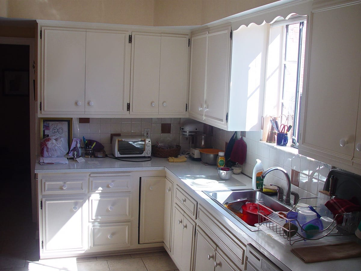 White on white outdated kitchen before remodeling by American Wood Reface