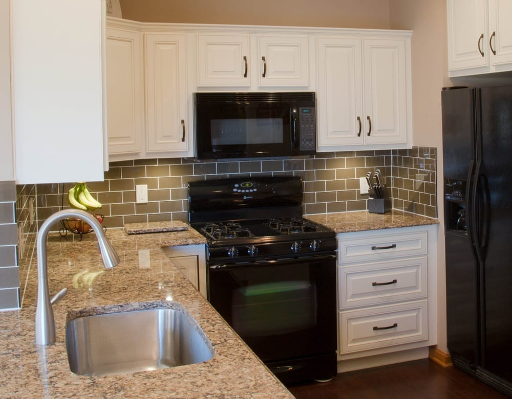 Traditional remodeled kitchen with new flooring and countertops by American Wood Reface