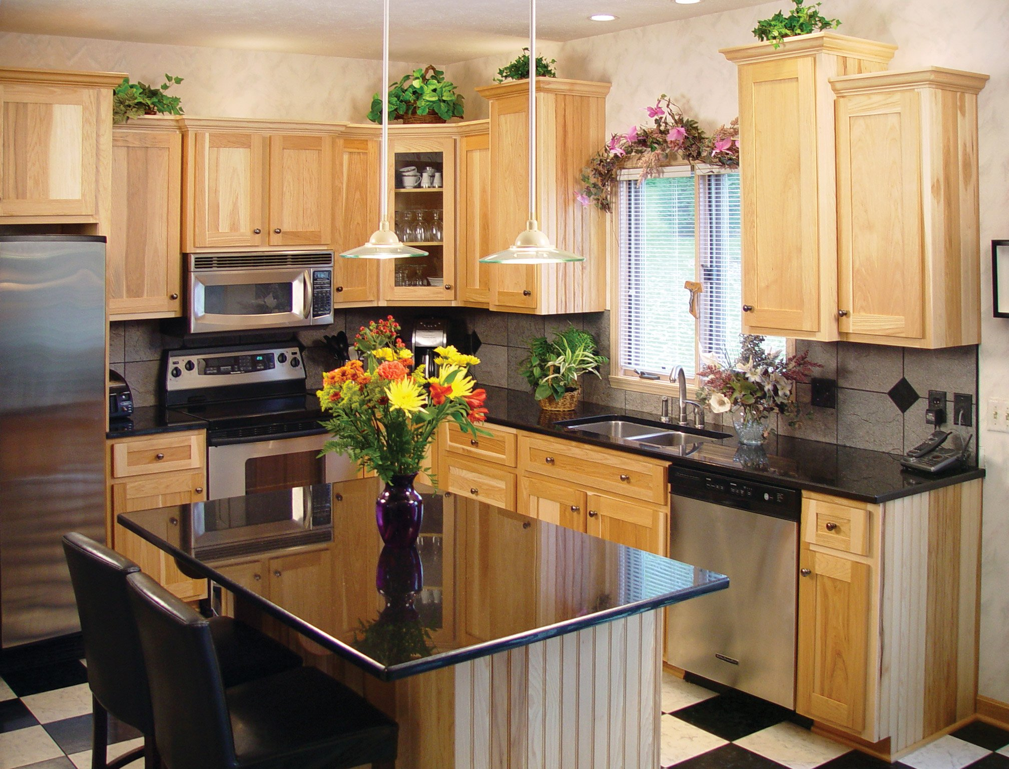 Flowers in a vase on an island in a refaced kitchen