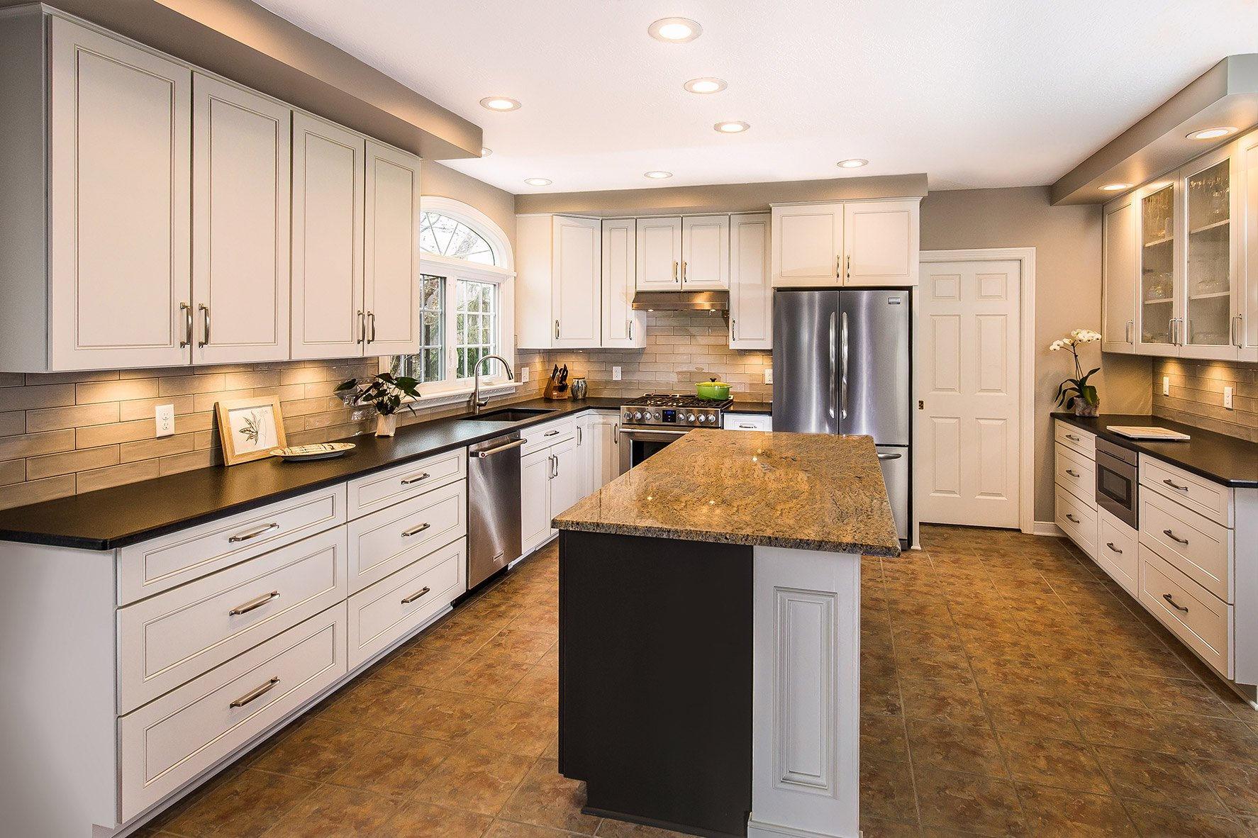 A refaced kitchen with new white cabinet doors