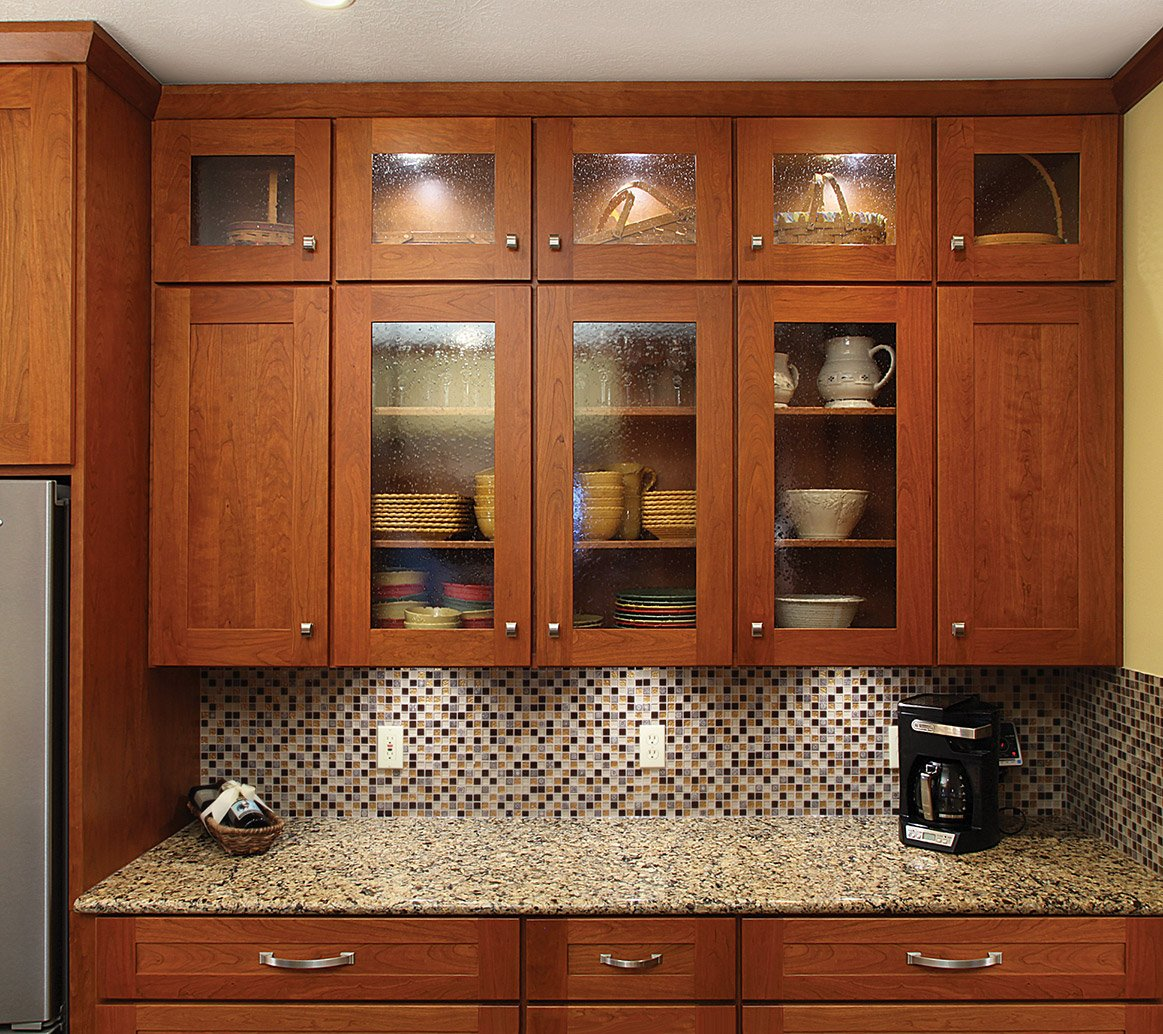 Refaced kitchen cabinets with partial glass doors