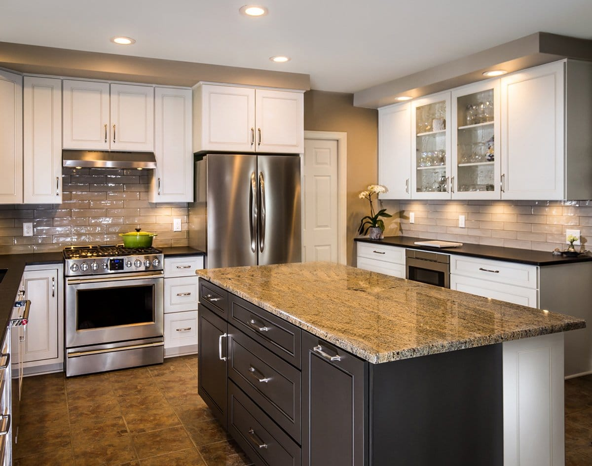 a picture of a beautiful kitchen refacing project with a kitchen cabinet extended to the ceiling with a center island and brown tiled countertops 1