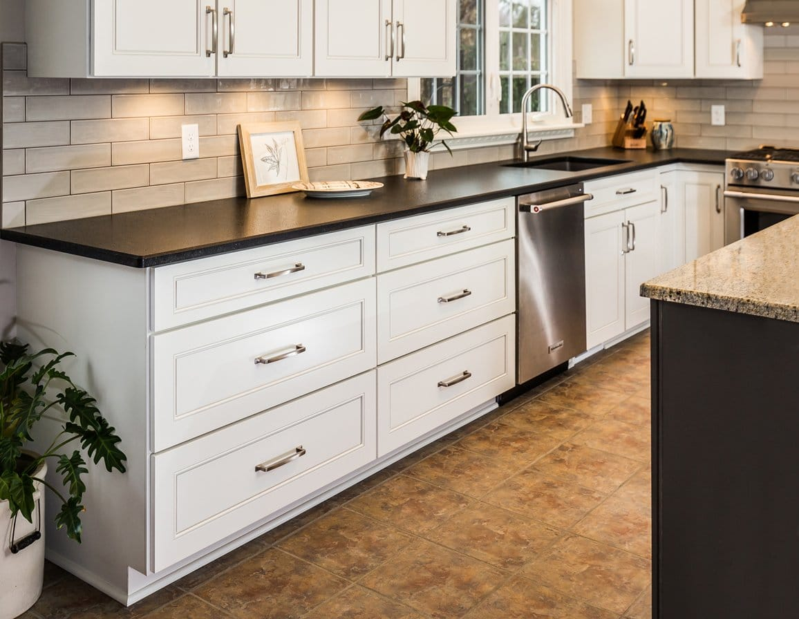 beautiful white kitchen cabinet with long countertops