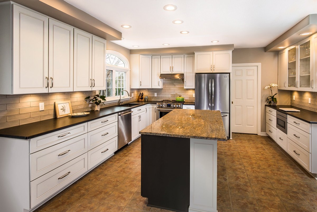 a side view picture of a beautiful kitchen refacing project with a kitchen cabinet extended to the ceiling with a center island and brown tiled countertops 1
